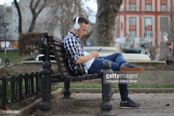 Young man enjoying in music