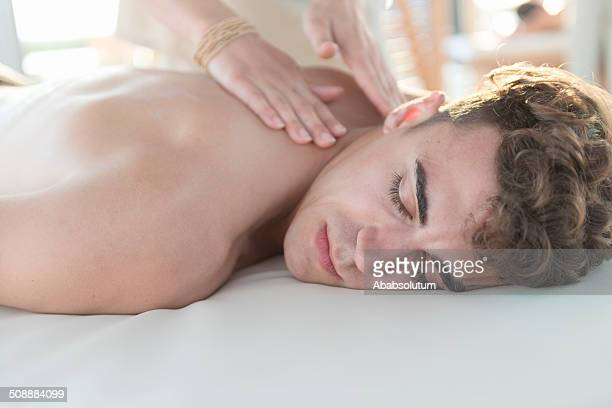 young man enjoying massage at spa outdoors, mediterranean, europe - sensual massage stock photos and pictures