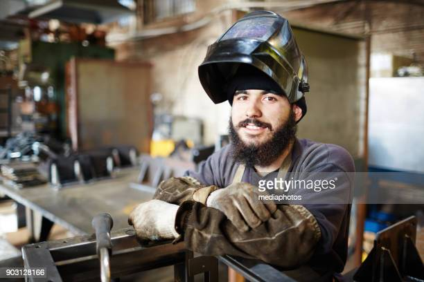 young man enjoying metalworking - satisfaction stock pictures, royalty-free photos & images