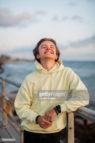 Young man enjoying sunset at seaside