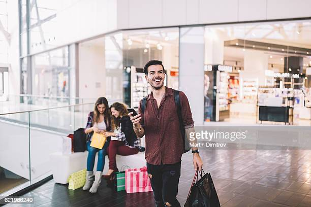 Young man enjoying the day in the shopping mall