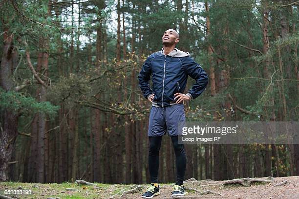 A young man enjoying the forest environment after a jog