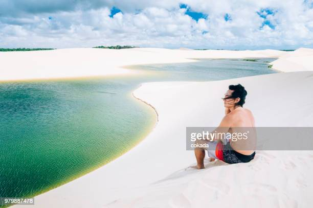 young man enjoying the outdoors - lencois maranhenses national park stock pictures, royalty-free photos & images