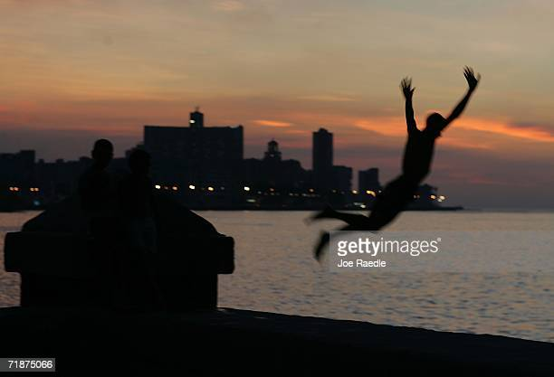 A young man enjoys a dive into the ocean off the Malecon September 12 2006 in Havana Cuba Cuba hosts the 14th NonAligned Nations Summit which...