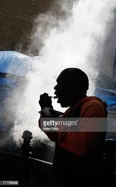 A young man enjoys Jamaican Jerk Chicken during the Notting Hill Carnival on August 27 2006 in London England People from all over the world meet in...