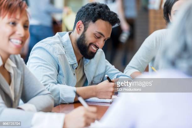Young man enjoys university study group