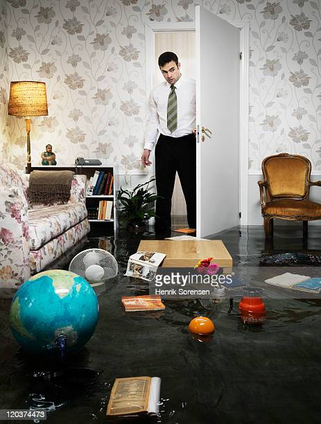young man entering flooded livingroom