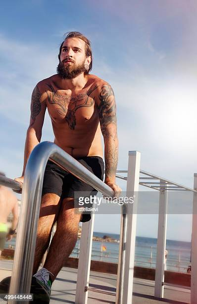 Young man exercising at the beach