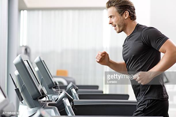 Young man exercising at the gym
