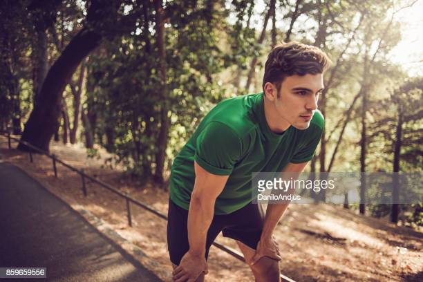 young man exercising in nature