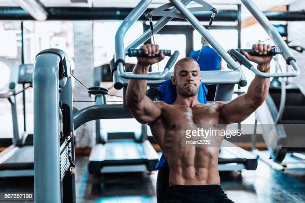 young man exercising in the fym - circuit training stock photos and pictures