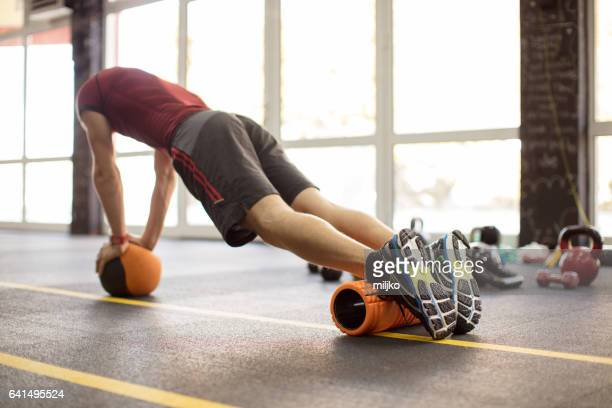 Young man exercising weight training in the gym