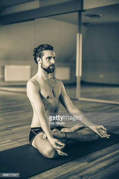 Young man exercising yoga