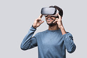 Young man experiencing virtual reality eyeglasses headset