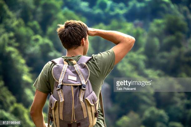 A young man exploring the Bodetal valley in Thale - Harz mountains, Thale, Saxony-Anhalt, Germany