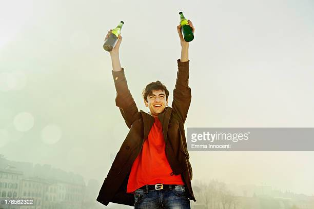 Young man exulting  with beer