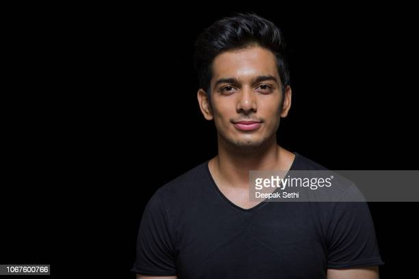 young man facial expression - stock image - black background stock pictures, royalty-free photos & images