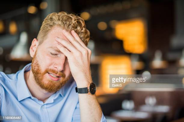 young man facing regret. - mistake stock pictures, royalty-free photos & images