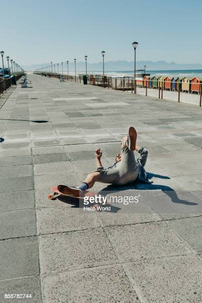 young man fallen off skateboard - bad luck stock pictures, royalty-free photos & images