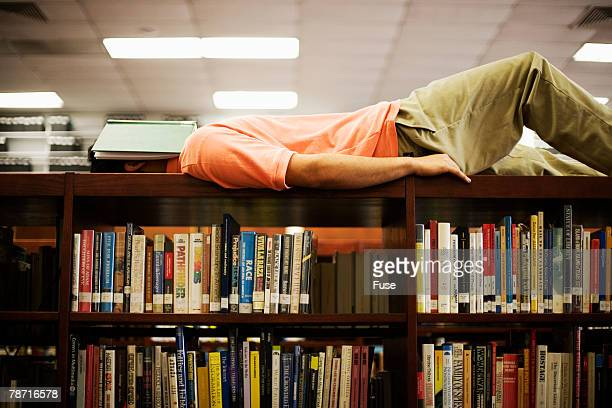Young Man Falling Asleep with Book on Face