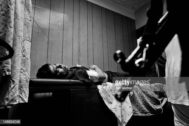 A young man fights for his life after being stabbed in the chest with a knife by a gang member on May 12 2011 in San Salvador El Salvador During the...