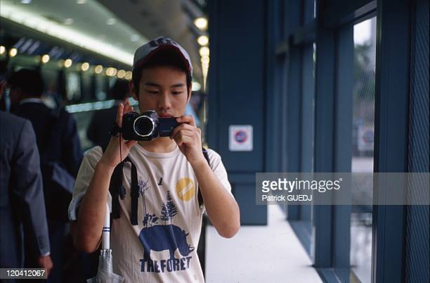 Young man filming the photographer in Ebisu Tokyo Japan