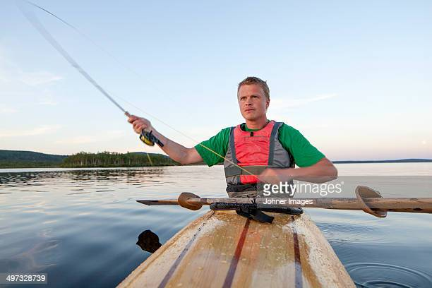 young man fishing, sweden - norrbotten province stock pictures, royalty-free photos & images