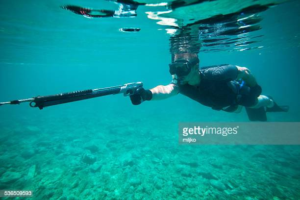 young man fishing whit speargun - spear stock pictures, royalty-free photos & images