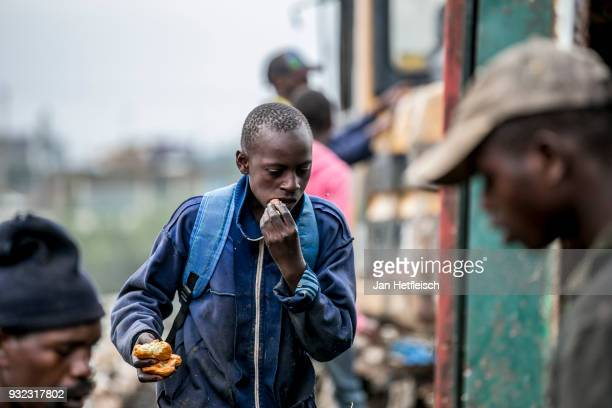 A young man found something to eat at the Dandora Rubbish dump on March 14 2018 in Nairobi Kenya The Dandora landfield is located 8 Kilometer east of...
