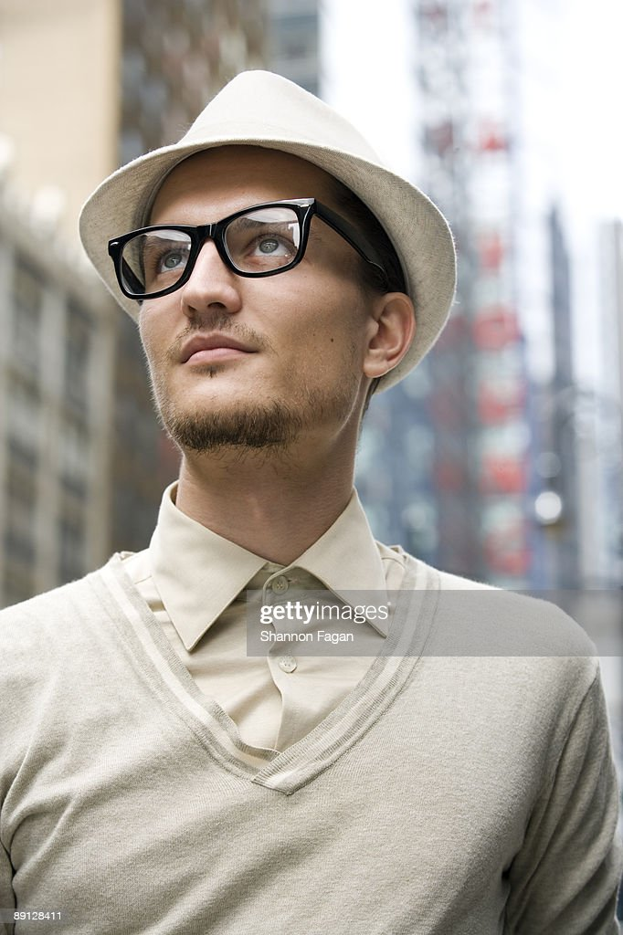 Young Man Gazing to Sky on City Streets : Stock Photo
