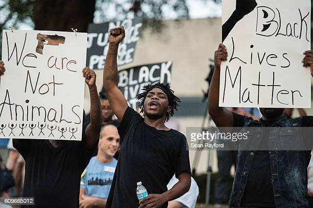 A young man gestures as he and others participate in in a protest at Marshall Park September 21 2016 in Charlotte NC The North Carolina governor has...