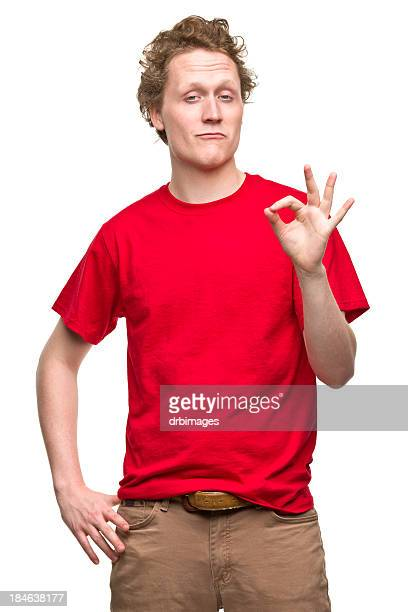Young Man Gestures Okay Hand Sign