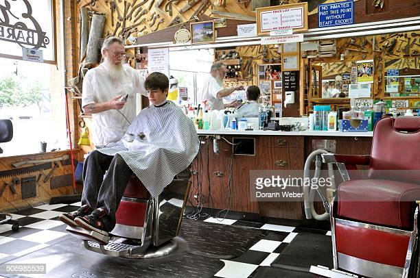 A young man gets a haircut at Ernie's Barbershop in Browns Mills New Jersey on July 29th 2014 The shop caters to many servicemen of nearby joint base...