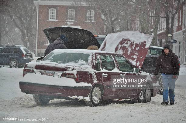 Young man gets a jump start from a good Samaritan on Main Street, Nantucket during the winter storm Chad Pierre Photography @Chad_Pierre Winter Storm...