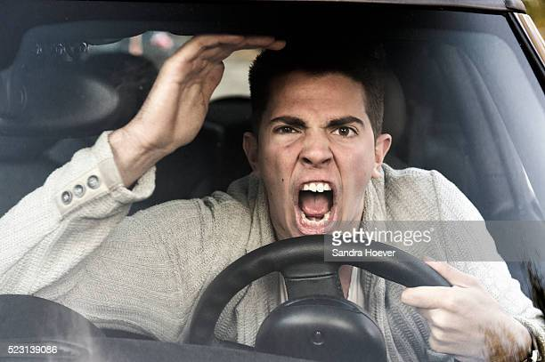 young man gets angry while driving the car