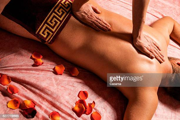 young man getting a back massage - sensual massage stock photos and pictures