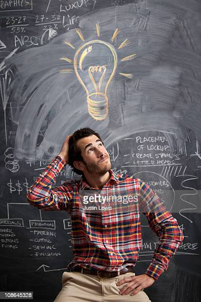 young man getting an idea with light bulb above