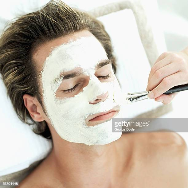 Young man getting face massage at a spa