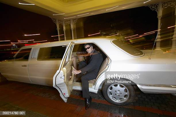 young man getting out of limousine, wearing sunglasses, portrait - appearance stock pictures, royalty-free photos & images