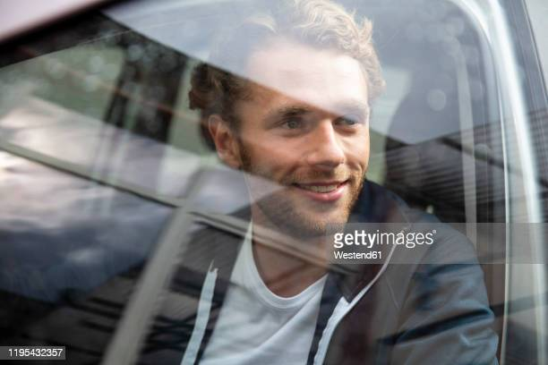 young man getting out of the car - getting out stock pictures, royalty-free photos & images