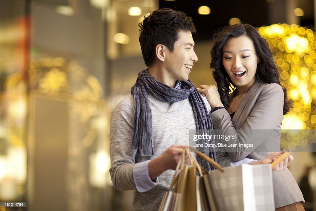 Young man giving a surprise to young woman : ストックフォト