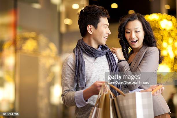 Young man giving a surprise to young woman