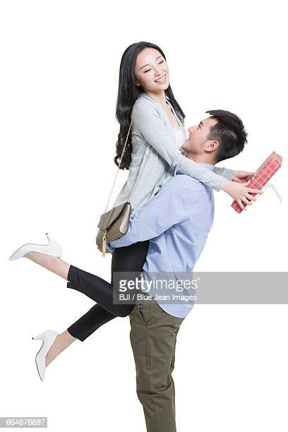 Young man giving gift to girlfriend