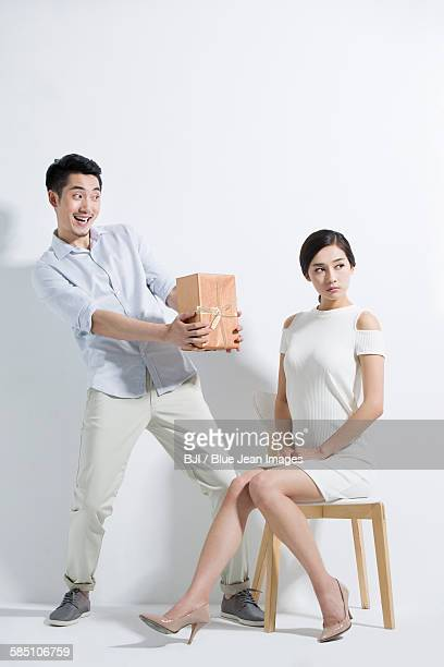 Young man giving girlfriend a gift