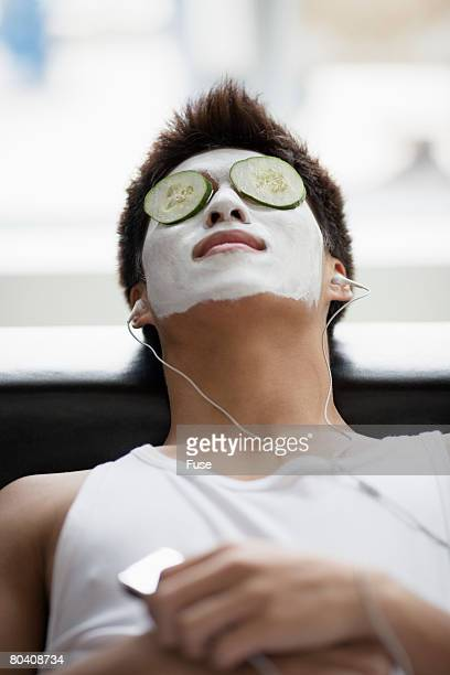 Young Man Giving Himself a Facial