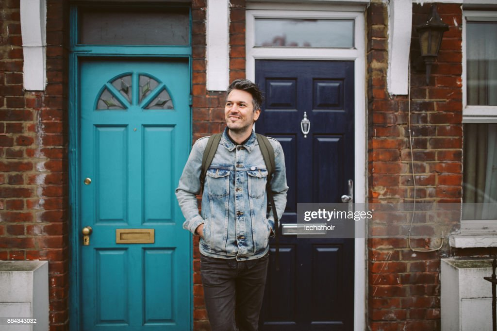 Young man going out to work from home : Stock Photo