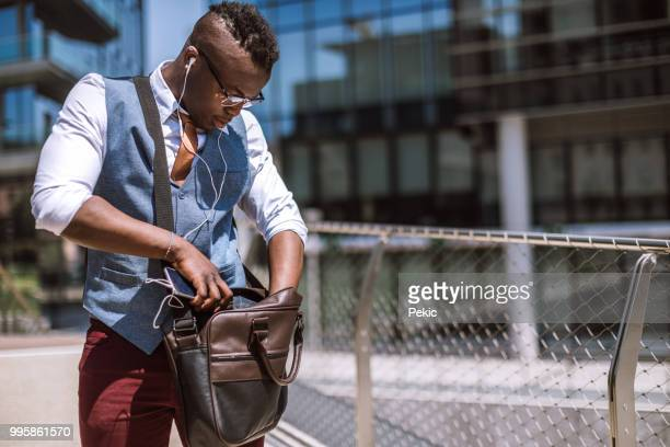 Young Man Going Through Things In His Bag