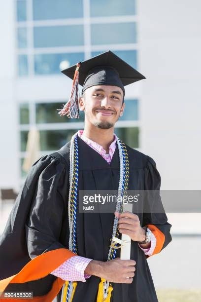 young man graduating from high school or university - graduation clothing stock pictures, royalty-free photos & images