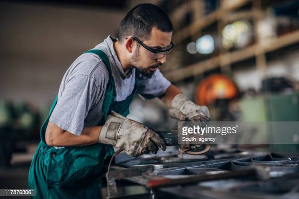 young man grinding - work glove stock pictures, royalty-free photos & images