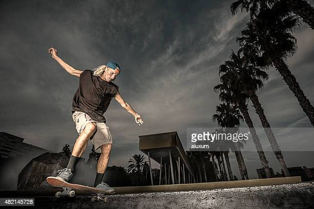 Young man grinding with his skateboard